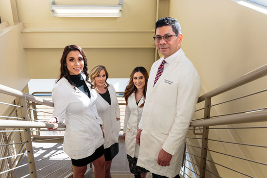 Staff in Stairwell - Renue Aesthetic Surgery - Dr. Victor Perez - Overland Park, KS