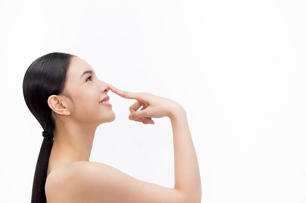 Woman-touching-nose.jpg