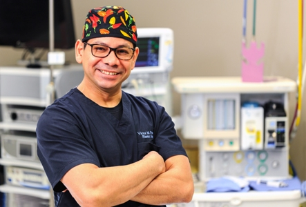 board-certified plastic surgeon Dr. Victor Perez in the operating room