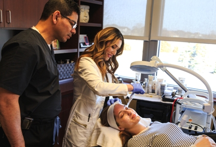 Dr. Perez and Cynthia performing cosmetic eyelid treatment