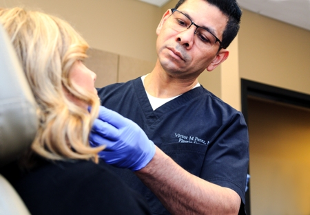 Dr. Victor Perez performing dermal facial filler injection