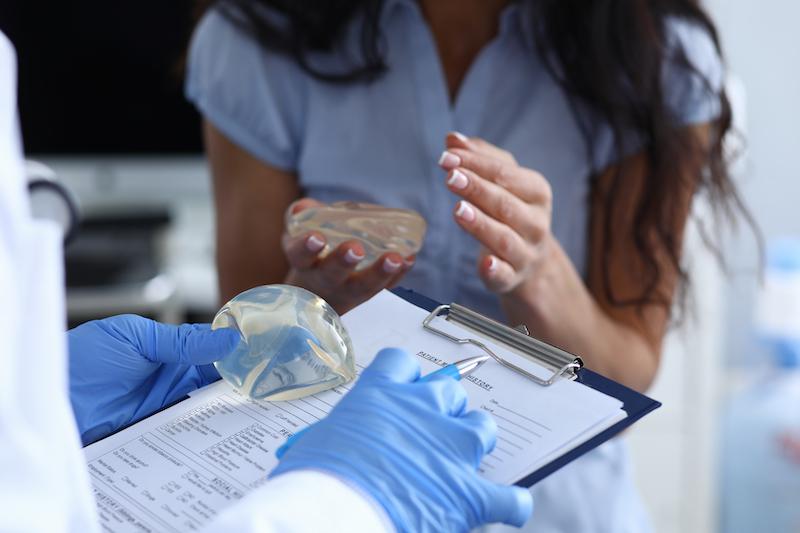Woman choosing breast implant size