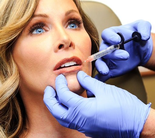 Beautiful woman getting lip injections at Renue Plastic Surgery