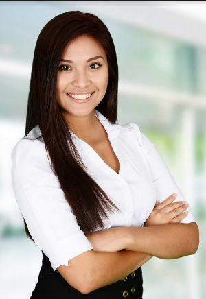 smiling professional woman standing with her arms folded