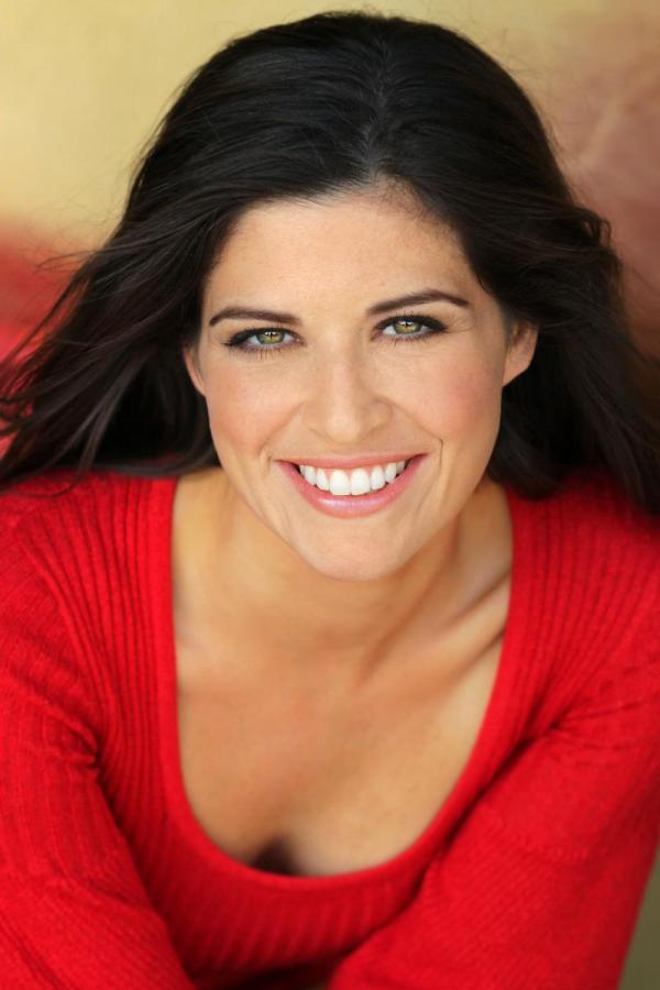 A Salt Lake City woman displays her gleaming dental implants
