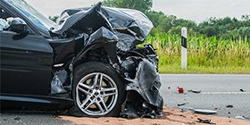 Car accident that caused a smashed front of the car and an injured driver