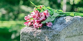 Flowers on a grave representing someone who was wrongfully killed