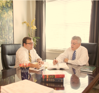attorneys Justin Williams and Dennis Williams work in our conference room