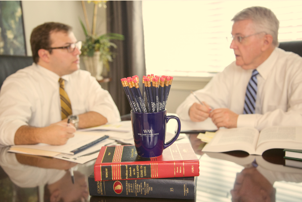 partner attorneys Justin Williams and Dennis Williams at a conference table